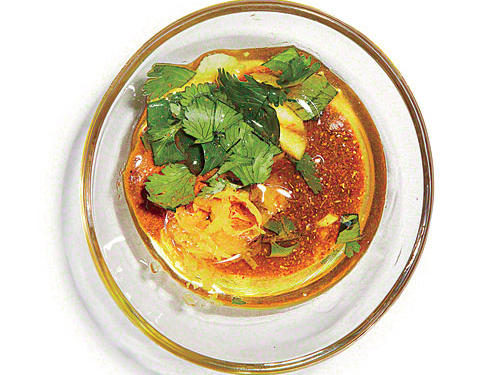 Combine 1 tablespoon canola oil, 1 teaspoon ground turmeric, 1 teaspoon Madras curry powder, 2 teaspoons finely chopped fresh cilantro, 1 teaspoon grated lemon rind, 1 teaspoon minced fresh garlic, and ¼ teaspoon kosher salt.SERVES: 4 (serving size: about 2 teaspoons)CALORIES 36 FAT 3.7g (sat 0.3g) SODIUM 120mg