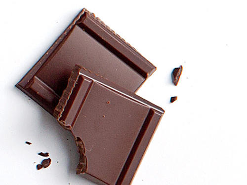 A sneaky source of caffeine, chocolate can contain as much caffeine as a soda depending on how much you eat. Dark chocolate, in particular, contains more caffeine compared to white and milk chocolate. While a couple of small squares will not necessarily disrupt sleep, eating a whole bar of chocolate before bed could mean tossing and turning all night.
