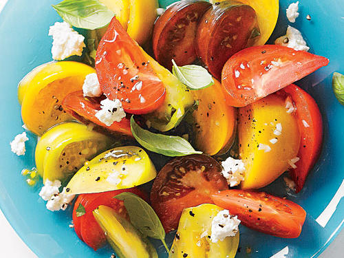 Our Tomato Salad with Goat Cheese and Basil is light and perfect as an outdoor summer side. Choose a variety of tomato colors to make the salad more beautiful without any additional work.