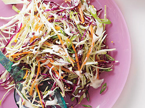 The traditional colors of Fat Tuesday celebrations are purple, green, and yellow, and this vibrant slaw mimics that combo. Use a mandoline or very sharp knife to cut the cabbage, and you'll avoid the rather strong smell that often comes when you shred it.
