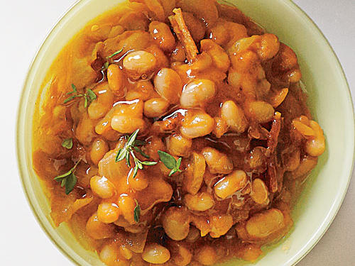 Our baked beans are cooked mostly on the stovetop and then briefly broiled for crusty edges. If you want extra herby flavor, garnish with fresh thyme leaves.