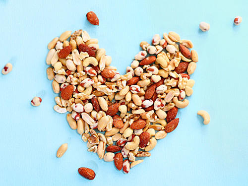 "An article in The Journal of Nutrition found that research participants who ate the most peanuts had a 35% reduced risk of coronary heart disease incidence. That means reducing your chances of dying from heart disease by over a third! Research stated that the fatty acid profile of the nuts, along with other components, reduced LDL-cholesterol, or ""bad cholesterol,"" resulting in healthier hearts."