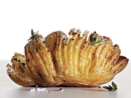 Once you eat a Hasselback potato, you'll wonder why you waited so long to try it. The increased surface area exposed to the oven's heat means you get lots of crispy edges, while the base of each slice still holds soft, tender flesh. It's a delicious effect that's easy to create: Cut most of the way through a potato at 1/8-inch intervals so that it looks like an accordion. A handy trick: Line up chopsticks or butter knives on both sides at the base of the tater; they'll stop the knife from going all the way through. Combine some olive oil, sea salt, pepper, herbs, and garlic, and brush over the potato, making sure the oil seeps between slices. Bake, uncovered, at 450° for 45 minutes to an hour, depending on the size and type of potato. Sprinkle with more fresh herbs.