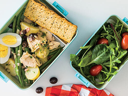 She'd rather be at a sidewalk table at the new French bistro, but a looming deadline has the die-hard foodie eating at her desk. With this deconstructed salade niçoise in her Foodie Bento Box, a girl can daydream.Make our recipe: Herby Potato, Green Bean, and Tuna SaladThen add...2 cups gourmet salad greens½ cup grape tomatoes2 multigrain, seeded flatbread crackers1 hard-cooked large egg, quartered2 tablespoons dark chocolate--covered espresso beansSERVES 2
