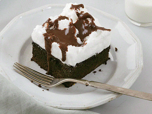 "Since 2006, readers have professed their love for contest winner Anna Ginsberg's One-Bowl Chocolate Mocha Cream Cake, touting it as the moistest cake ever. We agree—the cake is incredible. But online reviews suggested that the topping could use some tweaking. Instead of the original ""mocha cream"" of whipped topping, marshmallow creme, and coffee, we now have a creamy, less-sweet meringue. We also replaced reduced-fat mayonnaise (yes, mayo—it's the secret ingredient that makes for a fantastically moist cake) with canola mayo, our current product of choice."