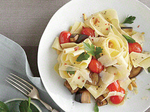 Bright grape tomatoes and fresh pecorino Romano cheese shine beautifully in this lovely weeknight dish. If allergies are an issue, simply omit the pine nuts.