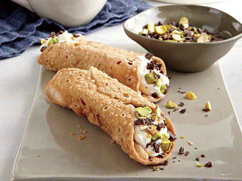 Chocolate and nuts are the perfect combination to top off sweetened ricotta and cream cheese in this cannoli. Swap out the pistachios for peanuts or almonds for a different taste.
