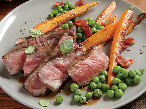 Herb-Rubbed New York Strip with Sautéed Peas and Carrots