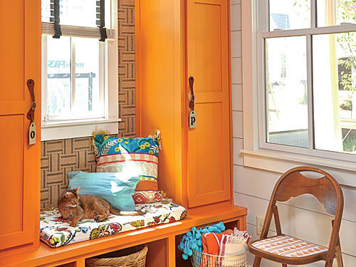 "For the orange mudroom, located right off the kitchen, Melanie crafted ""wallpaper"" from yards of thick jute chair webbing and wove it herself, tacking it with small nails, a creative move that cost her a whopping $6."