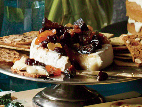 This lovely appetizer is about as quick and easy as it gets—and tasty, too. You don't even need to let the cheese come to room temperature first; the warm fruit that goes on top will soften it up. Serve with crostini or crackers.