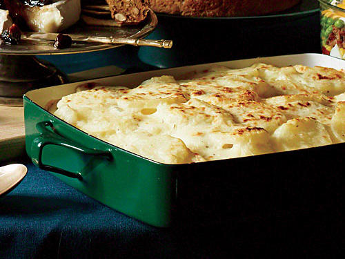 Refrigerated presliced potatoes slash tons of prep and cook time. The combo of Gruyère and Parm-Regg cheeses is delicious, but you can use all one type if you prefer.View Photo: Easy, Cheesy Potato Gratin