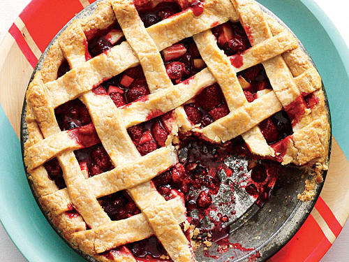 Add a splash of festive color to your dessert sideboard with this tangy fruity pie. For pretty rickrack-shaped lattice, cut the dough with a fluted pastry wheel.