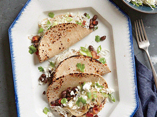 Canned beans that are already seasoned help bring these tacos together in a flash.