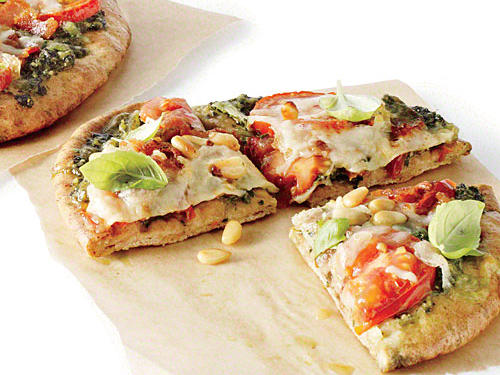 Make-ahead prep tip: Double the pesto portion of the recipe, and freeze half for a future pita pizza dinner.