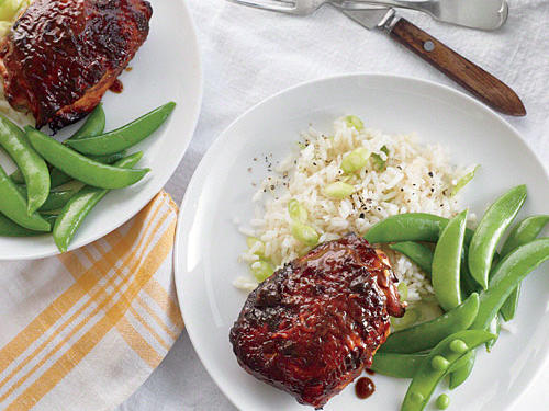 These chicken thighs are messy, but that's part of the fun. Serve with steamed sugar snap peas and hot cooked rice tossed with green onions.