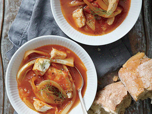 Arrabbiata, a spicy sauce of garlic, tomato, and chile pepper, forms the base for this stew. You can substitute cod or shrimp for the tilapia. Serve with crusty bread to mop up the sauce.