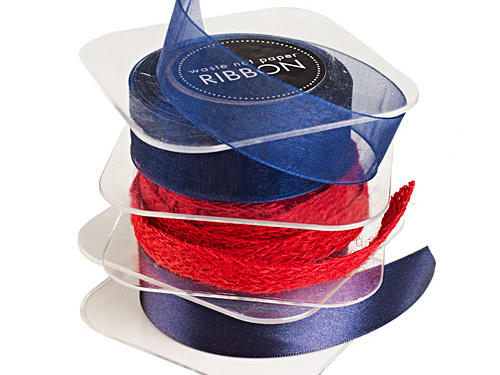Add a touch of elegance to packages with a bow of Night Satin Ribbon on top. $3.95-$6.95 per roll, paper-source.com. Or for a bit of rustic flair, try tying up gifts with this woven red burlap ribbon. $7.50 for 5 yards, paper-source.com.