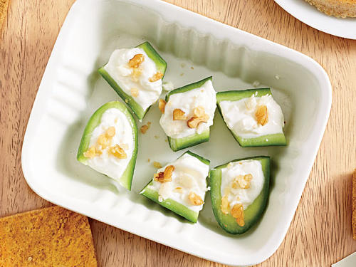 Cucumbers are a wonderful alternative to crackers during snack time. Top them off with a little cream cheese, nonfat Greek yogurt, feta cheese, and walnuts for a protein-packed crunch. Cute, portable, and easy, these are great party starters that guests will love snacking on. Tangy feta cheese steals the show and brightens up the vegetable base.