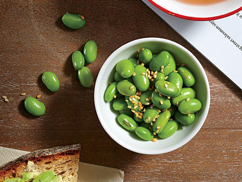 Boiled edamame sprinkled with sesame seeds and a dash of salt packs in 8g of protein in a half cup serving. Try this staff favorite sautéed or roasted, too.