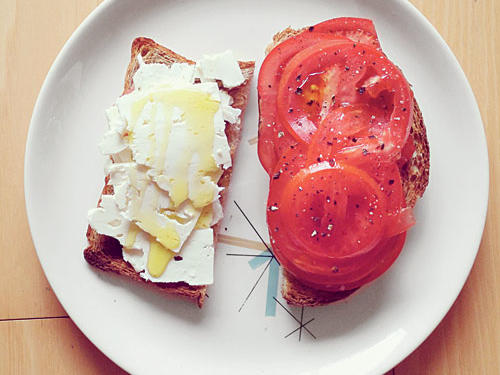 """Sliced sweet tomatoes and feta on seven-grain bread with the best olive oil—a typical Social Diet snack this summer"" – Scott Mowbray, The Project Nerd"