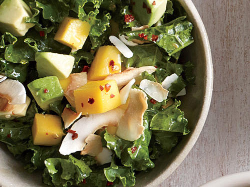 Kale salad goes tropical with an abundance of flavor from avocado, ripe mango, unsweetened coconut, and fresh lime-honey vinaigrette.