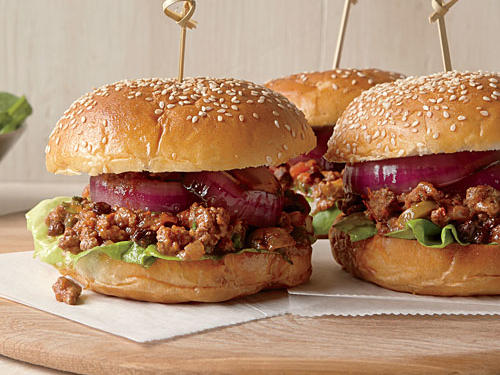 Turn this into a family-friendly meal and substitute diced green or red peppers for the pickled jalapeños. Whip up these Sloppy Joes in just 40 minutes by grilling the onions, toasting the buns, and preparing the salad all while the beef mixture cooks.