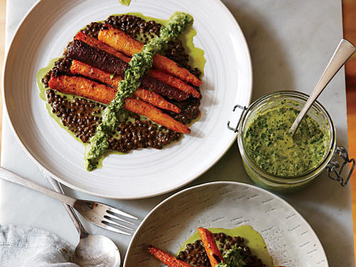 Cajun spiced lentils serve as a delicious protein component in this vegan meal, but what really makes this dish shine is the green harissa drizzled on top. The Tunisian-like sauce brings spice, tang, and bright herbiness to the sweet winter carrots.