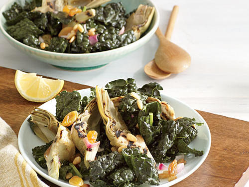 Kale offers the earthy flavor and chewy texture that make for supremely satisfying salads. A pressure cooker speeds the artichoke prep time. Pine nuts add crunch; plumped raisins balance the zingy Dijon-spiked dressing.