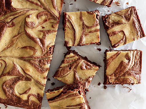 You start with brownies and then top them with a swirl of sweetened tahini that gives a delightful nutty depth of flavor and richness. Be sure to use untoasted sesame oil in the batter; the dark, toasted kind would be too strong.