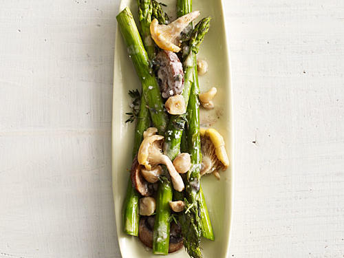 For a nutty, earthy, savory-sweet twist to your asparagus, add some sliced chanterelle mushrooms and chopped toasted hazelnuts.
