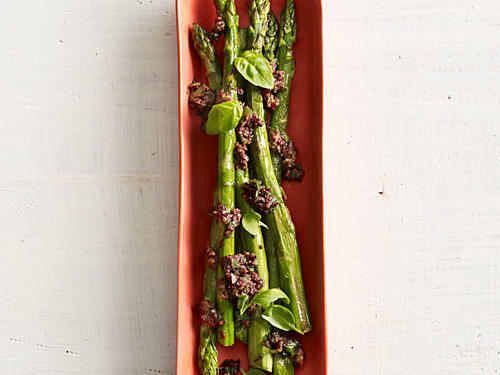 Kalamata and Castelvetrano olives really make this asparagus dish pop. Pair with a delicious orange-scented couscous salad for a perfect vegetarian feast.