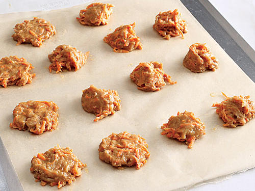 After scooping dough onto baking sheets, gently pat it down so that cookies bake generally flat; aim for 2-inch circles.