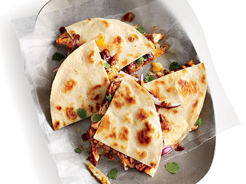 Crushed red pepper gives this barbecue chicken quesadilla a punch of heat. Crisp in a hot skillet with cooking spray instead of butter to save 7g sat fat.