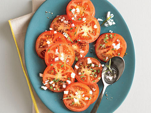 Beautiful, ripe, juicy tomatoes are a perfect summer side. We topped these sliced tomatoes off with shallot, fresh tarragon, and white wine vinegar for bright, refreshing side.