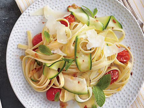Stirring olive oil into boiling water creates a quick emulsified sauce for this simple, summery pasta.
