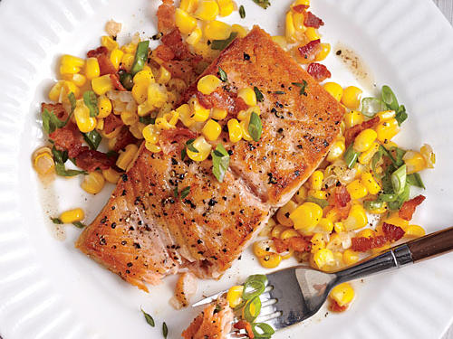 The corn-and-bacon sauté makes a sweet-and-savory bed for the fish. Let the fillets cook undisturbed over medium-high heat for a beautiful sear.