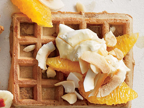 With the combination of orange, macadamia nuts, maple syrup, and coconut, you'll savor every last bite of this sweet, zesty waffle.