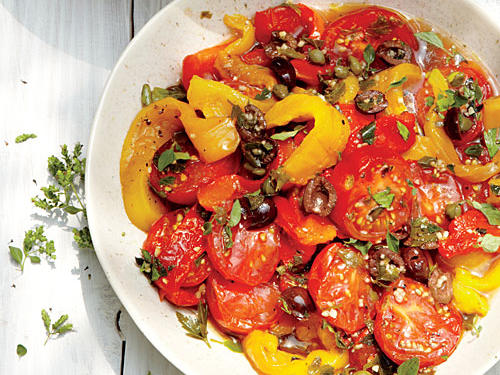 This dish is baked just long enough to bring out the juices of the tomatoes, then chilled. Serve it as a salad or a side dish. Keep the colors of the tomatoes and peppers the same, or vary them wildly. Campari tomatoes are commonly available at supermarkets; look for tomatoes that are smaller than the vine-ripened ones but larger than grape tomatoes (about 1½ inches wide).