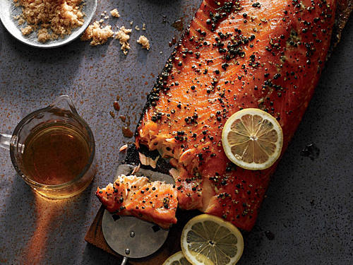 This whisky-scented smoked salmon combines the virtues of hot smoking and cedar planking. The dry brine in a sugar-salt mixture seasons the fish wonderfully.