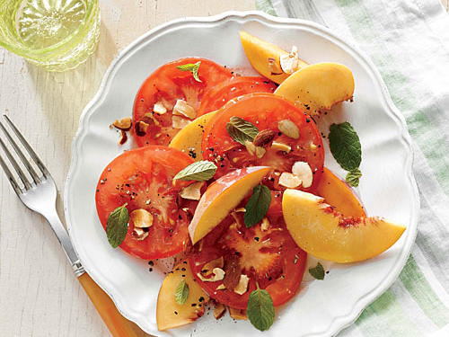 Ripe, meaty tomatoes star in this salad. Layer the peach slices between tomato slices. Choose small herb leaves, and keep them whole.