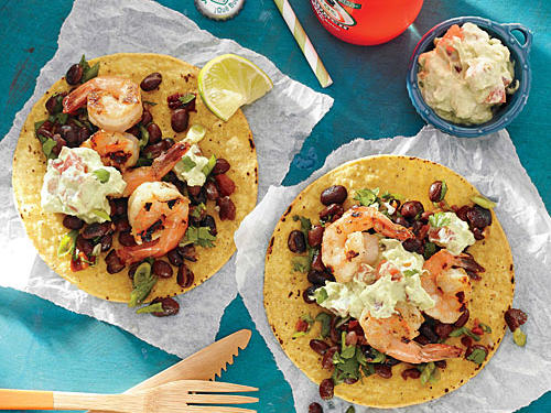 Grilled shrimp get the southwest treatment, enhanced by creamy avocado topping and black bean salsa.