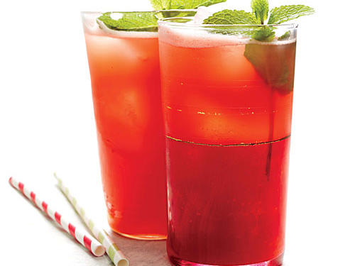 Turn fast food fruit drinks into a thing of the past, and trade up with a satisfying summer sipper made with fresh watermelon and lime juice. Garnished with a mint sprig, this hot pink beverage delivers cool refreshment on a hot summer day.