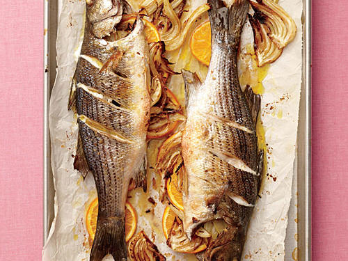 Roasting the fish whole keeps it tender and succulent. If you can't find striped bass, you can substitute whole white fish or yellowtail snapper, which are both sustainable options.