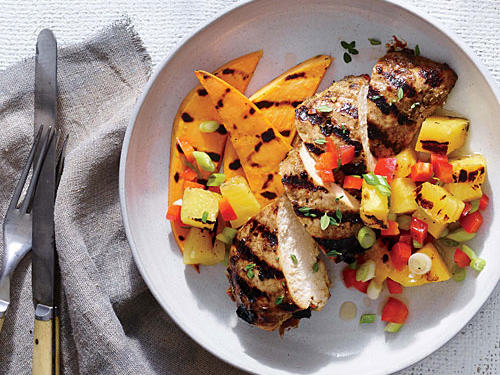 Get boldly flavored meat in a fraction of the time it takes traditional recipes by skipping the daylong marinade. This dish lends huge flavor to the chicken in just an hour. Grilled fruit salsa is the ideal cool complement.