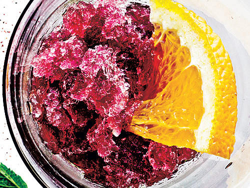 Think of this for your next summer get-together. This is the ultimate adult snow cone – booze included. The grape juice sweetens up the velvety red wine. Garnish with an orange and enjoy.