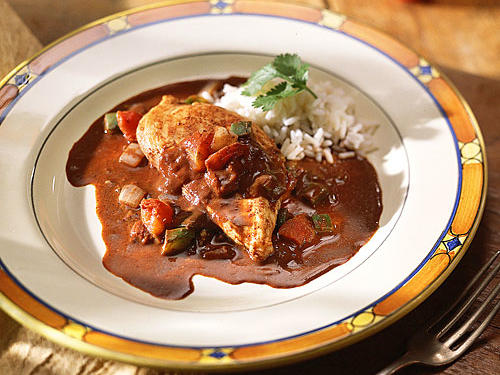 This Mexican chicken mole features chicken thighs and chicken breasts and it's so easy, you can make it in your microwave!  Serve over hot cooked rice and garnish with cilantro sprigs.