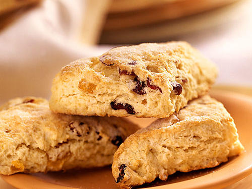 Dried cranberries and apricots, as well as orange rind, give these scones a sweet, tart flavor. But you can mix and match any dried fruits to create your own fruit scone.