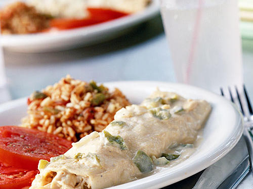These easy enchiladas are a wonderful way to use up cooked turkey or chicken. Serve with sliced tomatoes and Mexican rice for a well-rounded meal.
