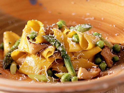 This homemade pasta dish was created by Chris Hastings, renowned chef at Hot and Hot Fish Club in Birmingham, Alabama.  The green peas and asparagus add a punch of gorgeous color, while the mushroom broth lends rich flavor to this recipe.