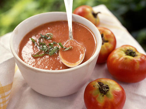 Fresh diced tomatoes and fresh herbs bring the garden to your table with this delicious tomato soup recipe. Garnish with thinly sliced fresh basil for an extra kick of freshness.